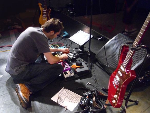 Paul Gilbert working on his pedal board